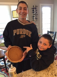 """Drew, left, with his little brother, Zach, holding the """"goods""""!"""